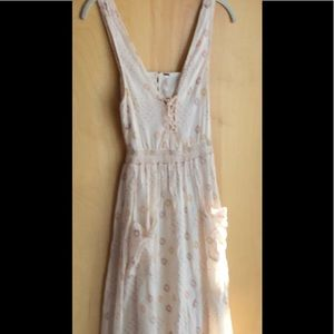 Free People pale pink sundress with lace-up chest